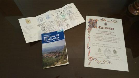 Pilgrim credentials, Sandy Brown's book, and Testimonium. (Photo: © Henri Craemer)